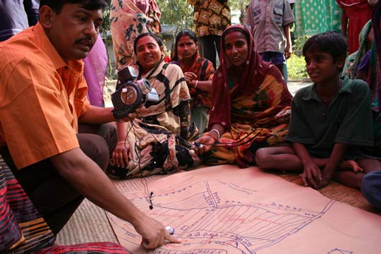 Participants study a map in Bangladesh. Photo: Isabelle Lemaire
