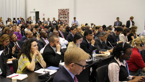 Participants meet at a side event during the 18th Conference of the Parties, Doha 2012