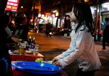 A young girl works as a waitress in Hanoi, Vietnam (Photo: Chris Goldberg, Creative Commons, via Flickr)