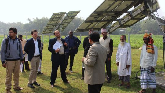 Officials on a climate finance course meet farmers in Bangladesh to learn about the benefits of solar irrigation pumps (Photo: ICCCAD, Creative Commons via Flickr)