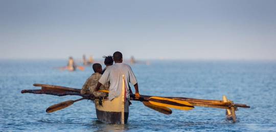 Madagascan fishermen set out for a day's fishing in traditional dugout canoes. Madagascar is implementing community-based management for some of its marine resources (Photo: Andreas Hafenscher, Creative Commons via Flickr)