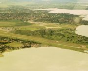 An aerial view of Entebbe airport. The airport is located on the shores ofLake Victoria, close to numerous environmentally sensitive wetland areas (Photo: Niranjanoak, Creative Commons via Wikipedia)