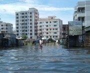 A man walking in a flooded street