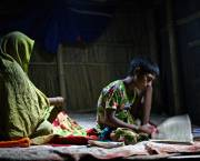 In the absence of electricity, students in Bangladesh are given charger lights so they can study at home (Photo: G.M.B. Akash/PANOS)