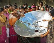 A community tests a solar cooker in India. The New Development Bank has made clean energy loans to South Africa and India. Solar concentrators to reduce and replace the use of conventional fuels that degrade the environment (Photo: UN Photo, Creative Commons, via Flickr)