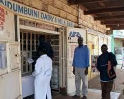 Customers at a milk bar in Ndumbuini in Kabete, Nairobi. Research in Kenya has found that milk sold in this way had similar bacterial levels to those sold in formal markets (Photo: ILRI/Paul Karaimu)
