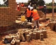 Demonstrating the use of alternative building materials at the Jinja Building Materials Training Centre, Uganda. (Photo: David Dodman)