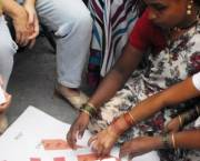Residents of an informal settlement in Pune, India, discuss the results of a survey and how best to upgrade their homes and settlement, guided by Mahila Milan, a grassroots network formed by savings groups of women slum and pavement dwellers (Photo: SPARC)