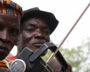 Men in Cote d'Ivoire listen to a radio.