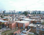 Buenos Aires, Argentina: luxury skyscrapers contrast with a shanty town of small brick dwellings with aluminium roofs. It is estimated that 10 per cent of the city's population lives in informal settlements (Photo: Mark Edwards/IIED)