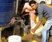 "There is no government-provided water connection in the Shivaji Nagar slum area of Raipur. Under UN definitions, a household has ""improved provision"" for water even if it only has access to a public tap or standpipe. (Photo: indiawaterportal.org, Creative Commons via Flickr)"