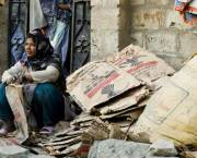 A woman sells cardboard on the streets of Karachi, Pakistan.