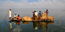 A group of fishermen on a boat in Bangladesh