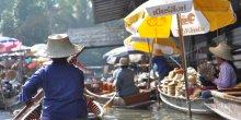 Women stallholders in small boats