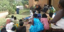 A volunteer health and conservation trainer gives a group talk to her community (Photo: Conservation Through Public Health)