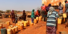 Women fetching water at a water kiosk