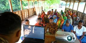 Group meeting on climate change on boat run by Shidhulai. Natore, Bangladesh. Photo: G.M.B. Akash/PANOS