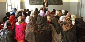 Schoolgirls and a teacher in a classroom