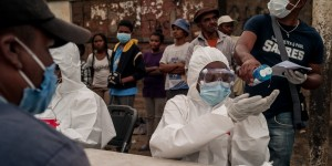 People wearing face masks and medical suits