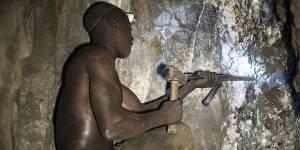 Fortunatus Waziri, a driller, works deep within a tunnel at the Nsangano Gold Mine, Mawemeru village in Geita District, Tanzania (Photo: Brian Sokol/Panos Pictures)