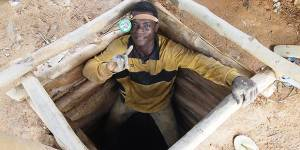 Working in shifts, an artisanal and small-scale miner in the Western region of Ghana relaxes at the top of a 15m mine shaft reinforced with a wooden 'cage' after several hours of digging (Photo: James McQuilken (@James_McQuilken/j.mcquilken@surrey.ac.uk))