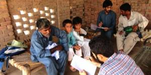 The TAMD method is being used to assess the impact of biogas plants in rural Pakistan. Here researchers talk to villagers in Sheikhuwal village (Photo: IIED)