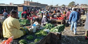 Busy market scene, showing traders with their vegetables