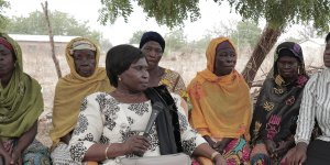 A group of seated African women gather for a discussion (Photo: Network for Women's Rights in Ghana (NETRIGHT))