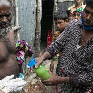 People using hand sanitiser