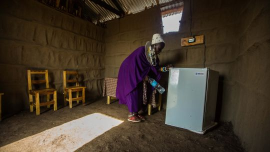 Esilalei, Tanzania: Teresia Olotai uses a refrigerator plugged into a solar powered micro-grid. Delivering energy access in rural Tanzania could help transform local economies (Photo: Morgana Wingard, USAID, Creative Commons via Flickr)